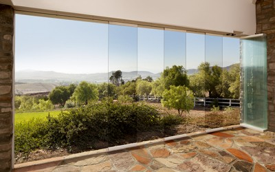 Frameless sliding stacking system frameless glass patio for Glass wall door systems