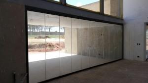Frameless glass sliding stacking system